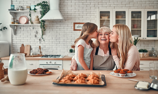 494086690 istock photo Daughter, mother and grandmother on kitchen 1135163155