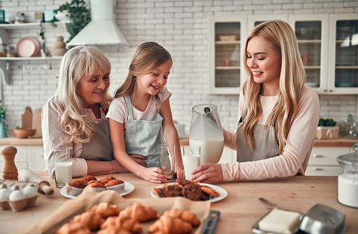 494086690 istock photo Daughter, mother and grandmother on kitchen 1135163234