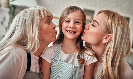 494086690 istock photo Daughter, mother and grandmother on kitchen 1135163424