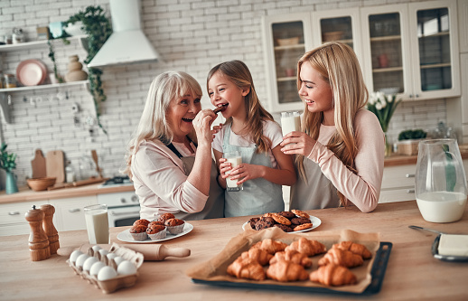 494086690 istock photo Daughter, mother and grandmother on kitchen 1135163456