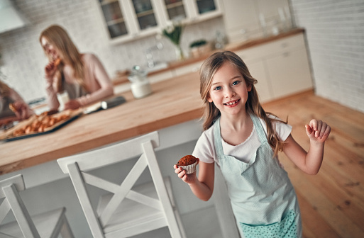 494086690 istock photo Daughter, mother and grandmother on kitchen 1135163492