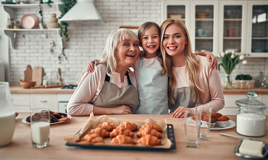 494086690 istock photo Daughter, mother and grandmother on kitchen 1135163604