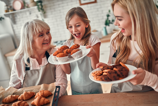 494086690 istock photo Daughter, mother and grandmother on kitchen 1135163613