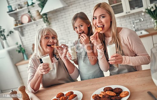494086690istockphoto Daughter, mother and grandmother on kitchen 1135163712
