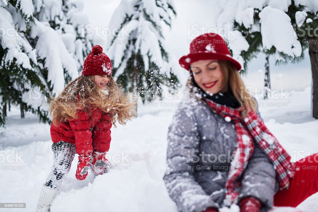 daughter provokes mother play stock photo
