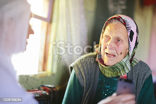 A Turkish daughter is showing something to her mother.