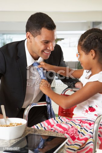 istock Daughter Straightens Father's Tie Before He Leaves For Work 178984337