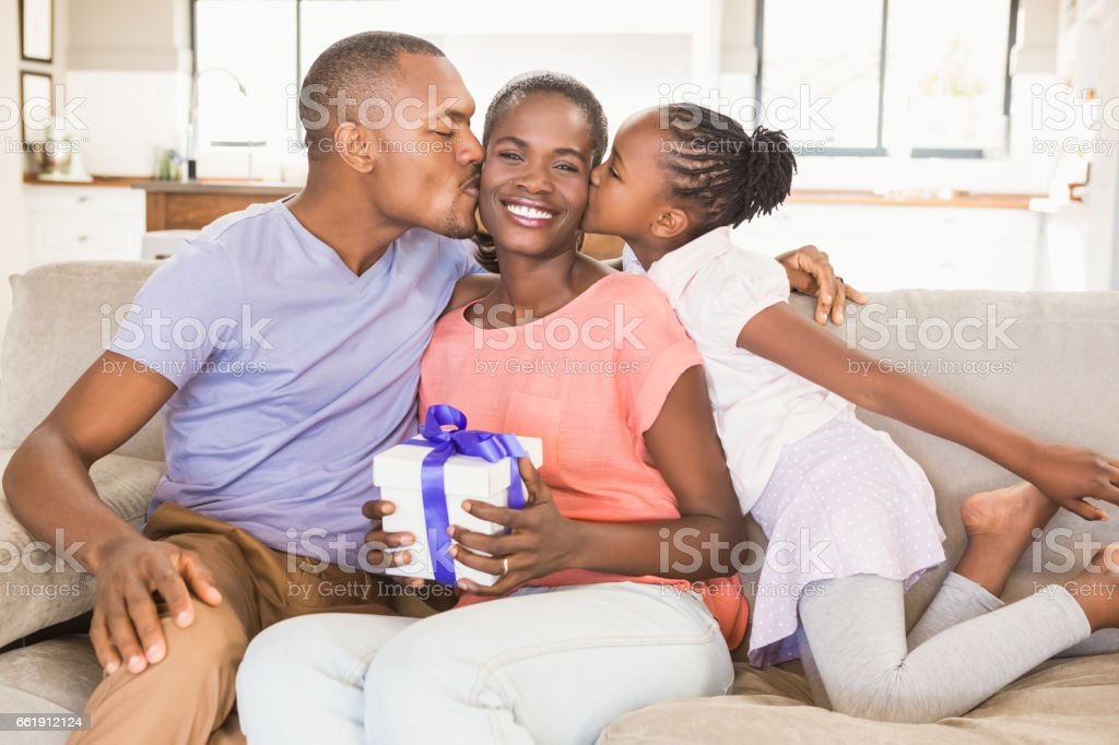 Daughter surprising mother with a present stock photo