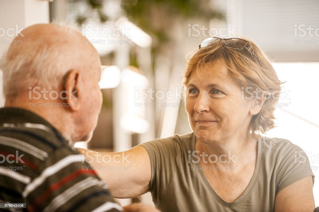 Daughter Visiting Father In The Retirement Community stock photo