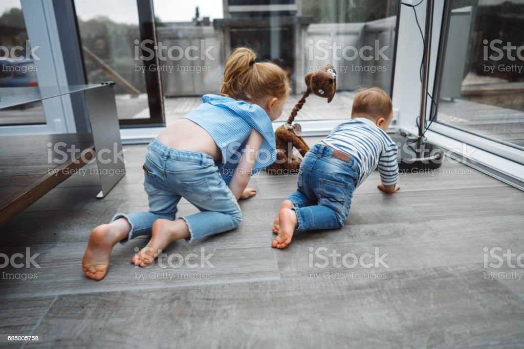 daughters and a little son on the floor Lizenzfreies stock-foto