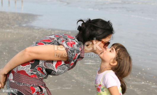 istock daughter's kiss 91603612