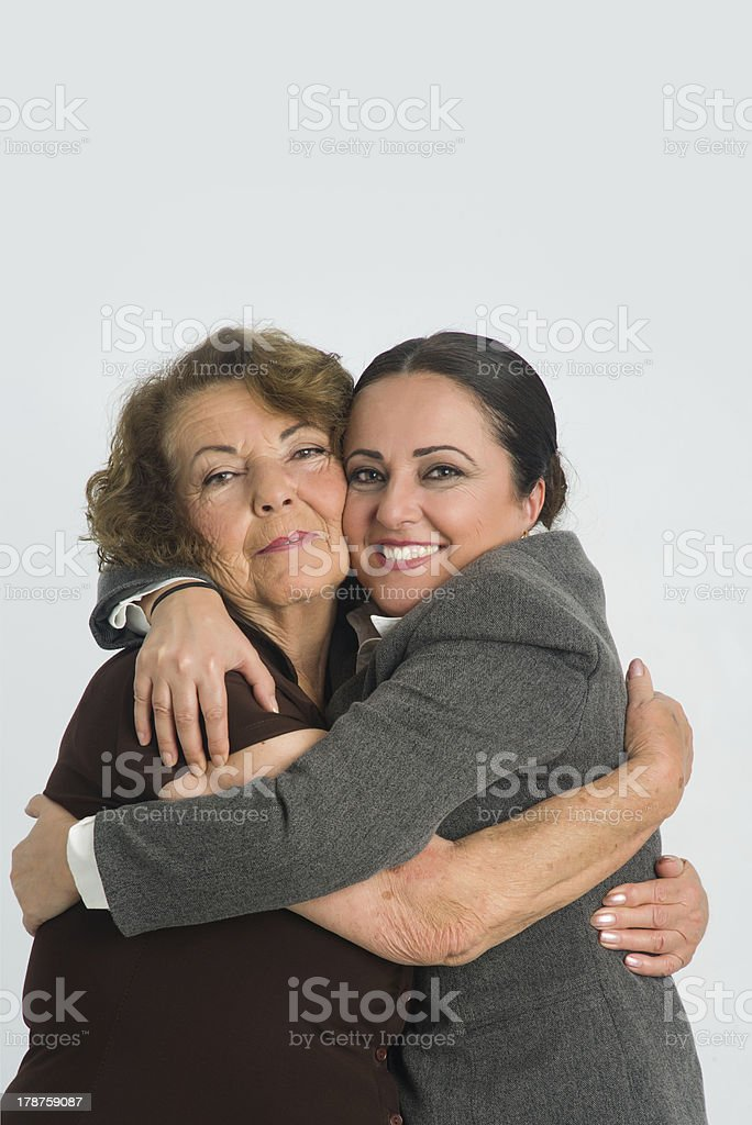 Daugter is hugging her mother royalty-free stock photo