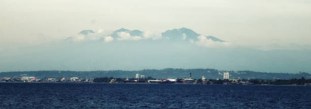 Davao city and Mount Apo City of Davao is a highly urbanized city in the island of Mindanao, Philippines. apothegm stock pictures, royalty-free photos & images