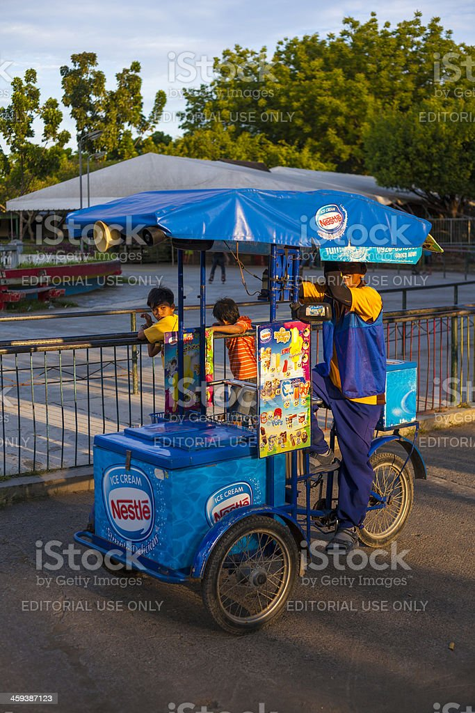 Davao, Philippines: Ice-cream cart with vendor and two children royalty-free stock photo