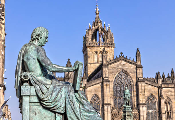 David Hume Statue and St Giles Cathedral in Edinburgh , Scotland stock photo