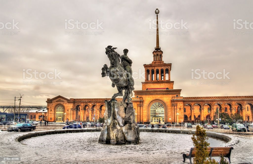David of Sassoun statue and Yerevan Railway Station stock photo