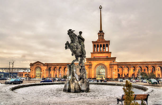 David of Sassoun statue and Yerevan Railway Station David of Sassoun statue and Yerevan Railway Station - Armenia tuff stock pictures, royalty-free photos & images