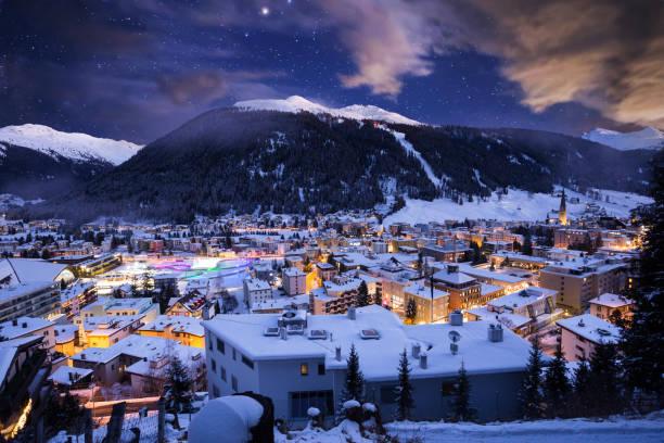 davos city winter blue hour night scene. davos, switzerland - швейцария стоковые фото и изображения