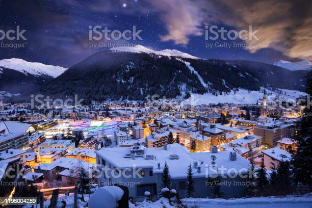 Photo of Davos city winter blue hour night scene. Davos, Switzerland