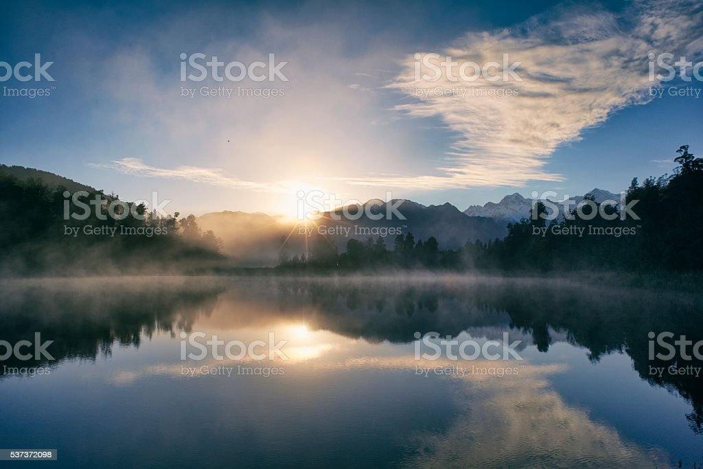 Dawn on New Zealand\'s South Island, and the Southern Alps are...