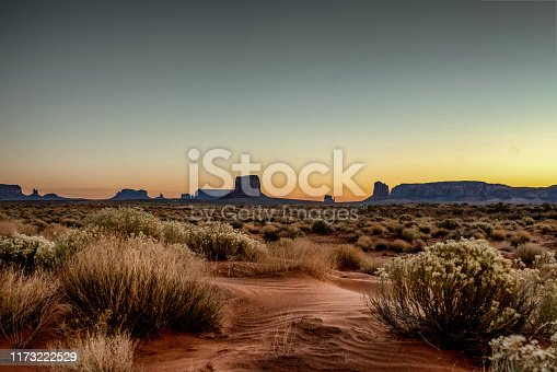 Dawn at Monument Valley Tribal Park with Beautiful Desert Sand in Front of the Majestic Mitten Bluffs of the Tribal Park