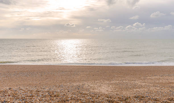 dawn at the beach. - english channel stock pictures, royalty-free photos & images