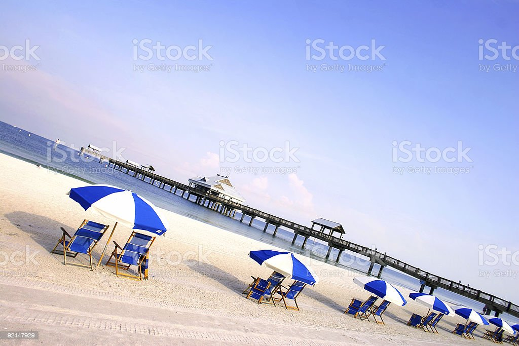 Dawn at the beach with Bella's and chairs royalty-free stock photo