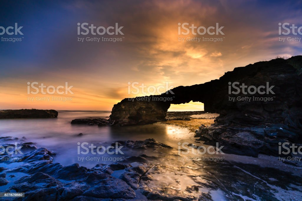 dawn at the gate port volcanic rock on Ly Son island stock photo
