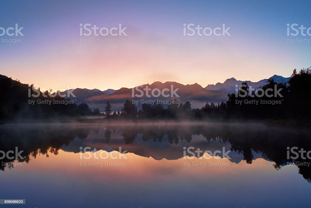 Dawn Breaks Over Lake Matheson In New Zealand stock photo