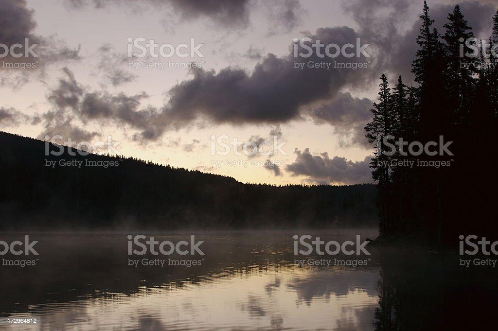 Dawn Fog over a lake stock photo