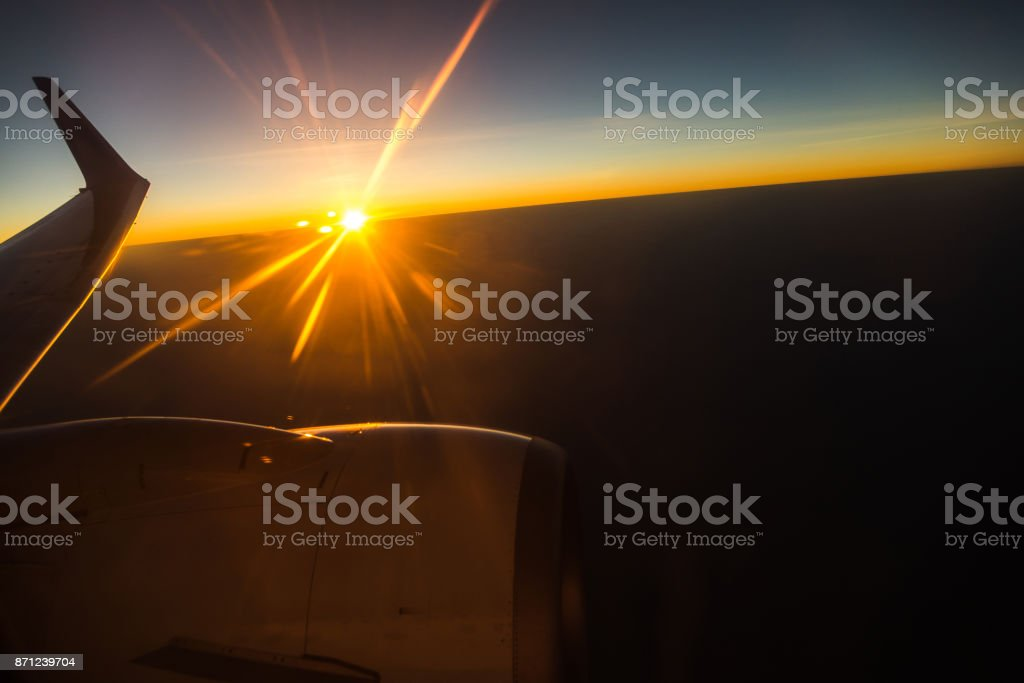 Dawn from the airplane window stock photo