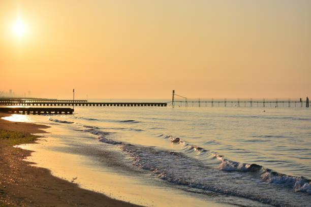 Dawn illuminates the beautiful beaches of piers and moorings
