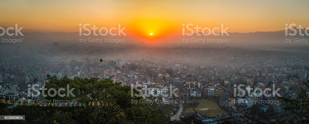 Dawn in Kathmandu golden sunrise over crowded cityscape panorama Nepal stock photo