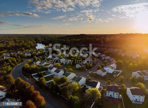 Dawn in the sleeping area of a small town with a forest on the background. View from a height
