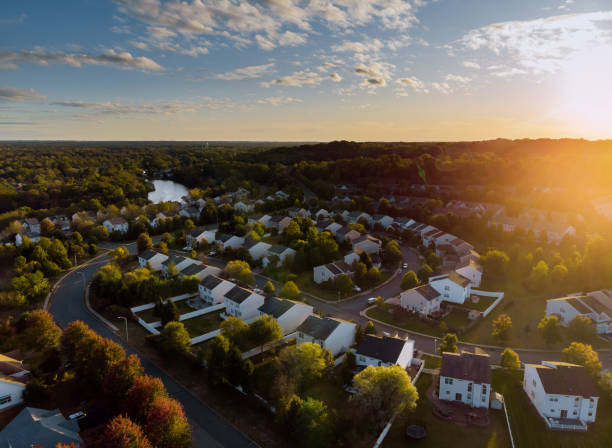 Dawn in the sleeping area of a small town with a forest on the view from a height Dawn in the sleeping area of a small town with a forest on the background. View from a height residential district stock pictures, royalty-free photos & images
