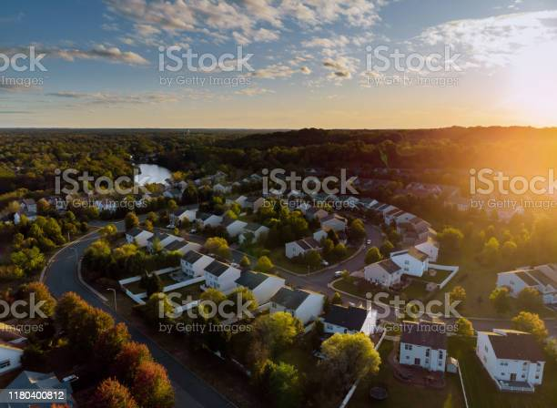 Photo of Dawn in the sleeping area of a small town with a forest on the view from a height