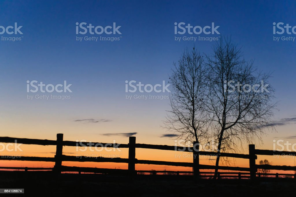 Dawn in the village fence royalty-free stock photo