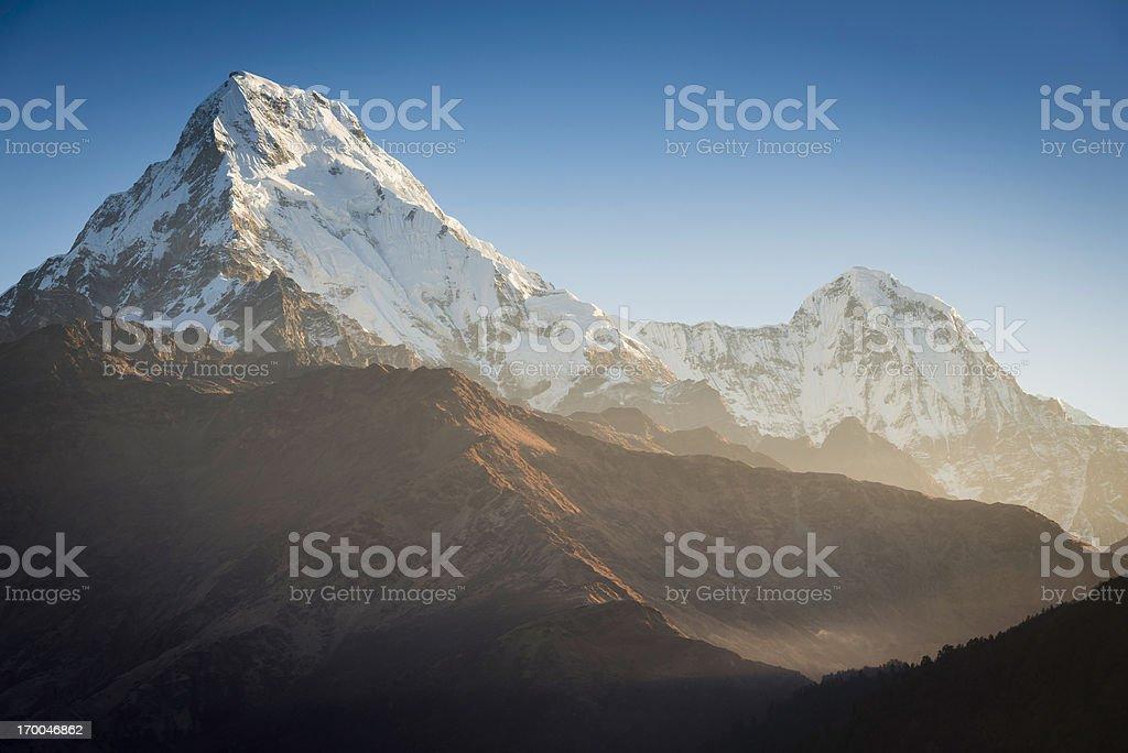 Dawn light on dramatic snow mountain peak Annapurna Himalayas Nepal royalty-free stock photo