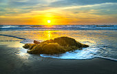 Dawn on the beautiful beach with basket boat, moss or rocky beaches welcome beautiful new day