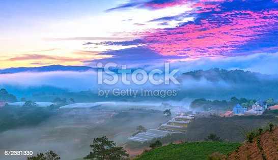 1034754000istockphoto Dawn on the hill with a lot of mist, sky in the dramatic clouds welcome new day on the plateau of Da Lat, Vietnam 672331330