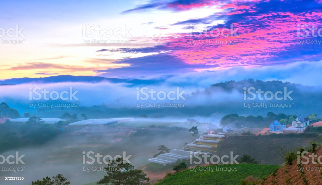 Dawn on the hill with a lot of mist, sky in the dramatic clouds welcome new day on the plateau of Da Lat, Vietnam stock photo