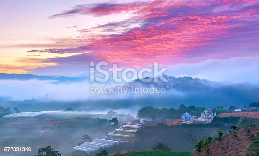 1034754000istockphoto Dawn on the hill with a lot of mist, sky in the dramatic clouds welcome new day on the plateau of Da Lat, Vietnam 672331346