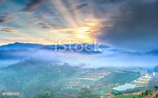 1034754000istockphoto Dawn on the hill with a lot of mist, sky in the dramatic clouds welcome new day on the plateau of Da Lat, Vietnam 672331370
