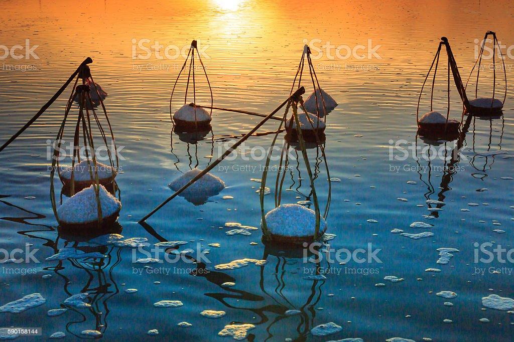 Dawn on the Hon Khoi salt field stock photo