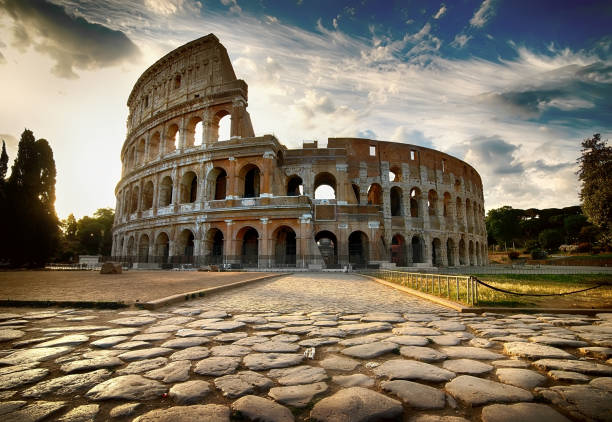 Dawn over Colosseum Cloudy dawn over roman Colosseum in Italy ancient rome stock pictures, royalty-free photos & images