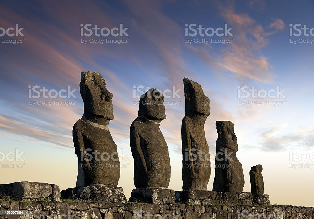 Dawn over Moais at Ahu Tahai on Easter Island Chile stock photo