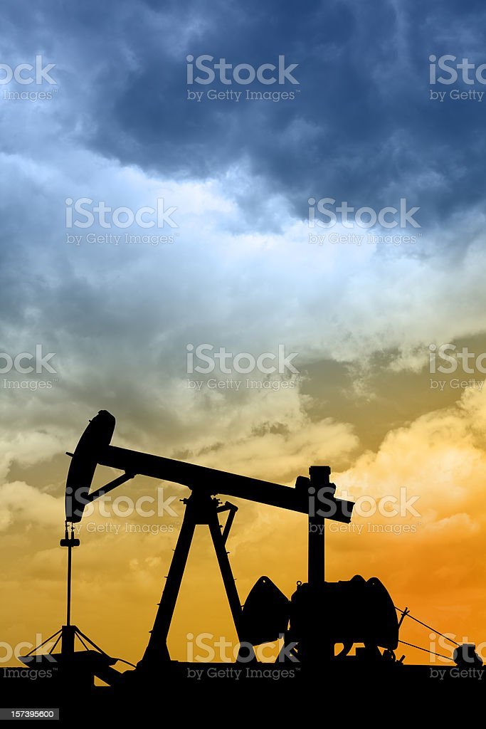 Dawn over petroleum pump in the desert royalty-free stock photo
