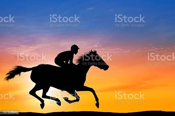 Dawn over professional jockey riding a racehorse picture id157509042?b=1&k=6&m=157509042&s=612x612&h=1fngvefkngugmp0b 7gl2fapvyjdbdj1bd7c6dblhxo=