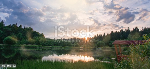 istock Dawn over the river in silent summer day 697369192