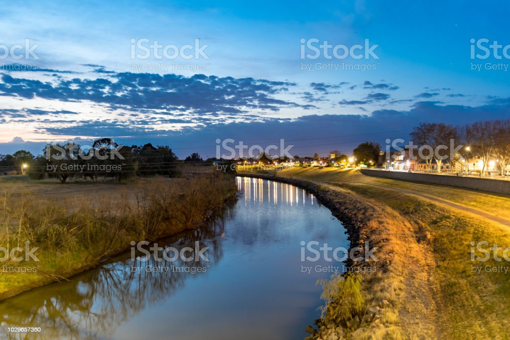 Dawn over the town River stock photo